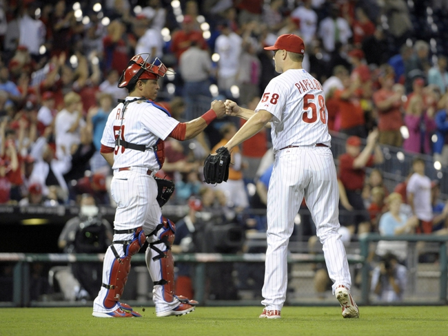 Aug 22, 2014; Philadelphia, PA, USA; Philadelphia Phillies catcher Carlos Ruiz (51) and relief pitcher Jonathan Papelbon (58) celebrates win against the St. Louis Cardinals at Citizens Bank Park. The Phillies defeated the Cardinals, 5-4. Mandatory Credit: Eric Hartline-USA TODAY Sports