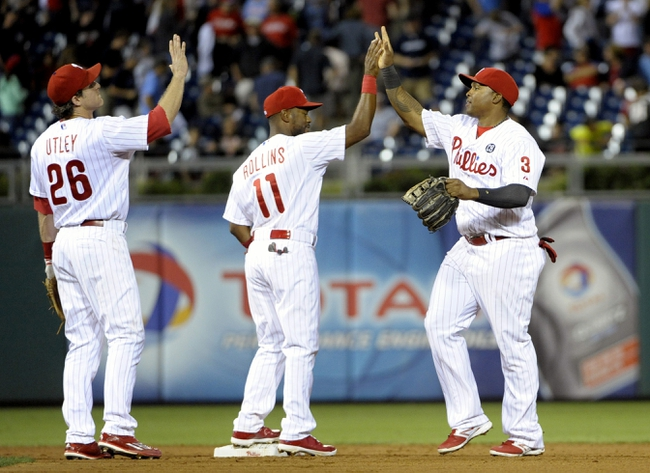 Aug 22, 2014; Philadelphia, PA, USA; Philadelphia Phillies second baseman Chase Utley (26), shortstop Jimmy Rollins (11) and right fielder Marlon Byrd (3) celebrate win against the St. Louis Cardinals at Citizens Bank Park. The Phillies defeated the Cardinals, 5-4. Mandatory Credit: Eric Hartline-USA TODAY Sports