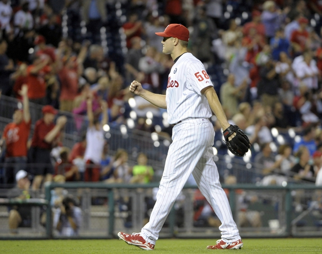 Aug 22, 2014; Philadelphia, PA, USA; Philadelphia Phillies relief pitcher Jonathan Papelbon (58) celebrates the final out against the St. Louis Cardinals at Citizens Bank Park. The Phillies defeated the Cardinals, 5-4. Mandatory Credit: Eric Hartline-USA TODAY Sports