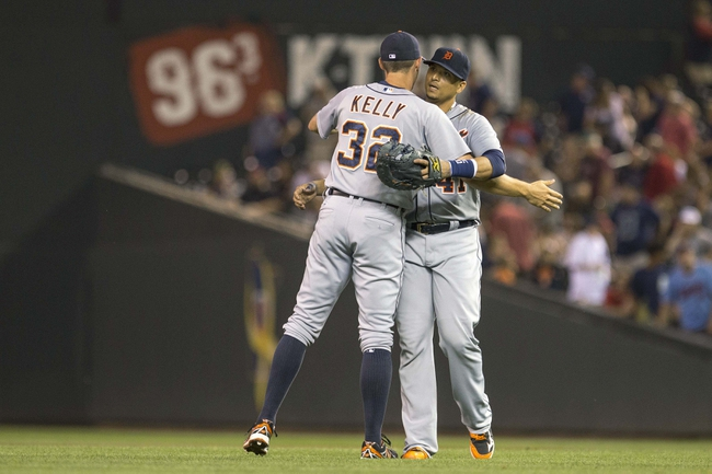 Aug 23, 2014; Minneapolis, MN, USA; Detroit Tigers third baseman Don Kelly (32) celebrates with first baseman Victor Martinez (41) after beating the Minnesota Twins at Target Field. The Tigers won 8-6. Mandatory Credit: Jesse Johnson-USA TODAY Sports