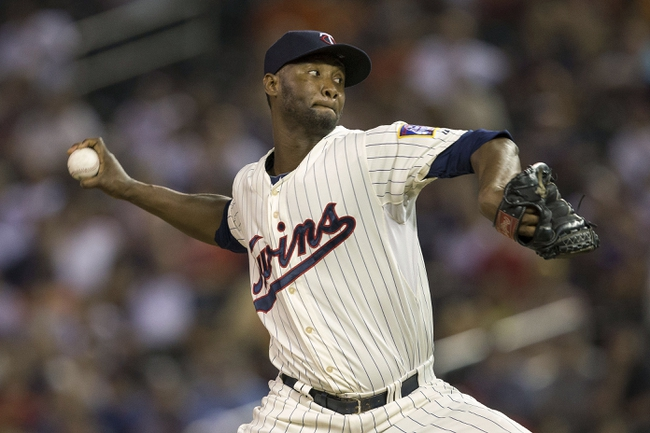 Aug 23, 2014; Minneapolis, MN, USA; Minnesota Twins relief pitcher Samuel Deduno (21) delivers a pitch in the ninth inning against the Detroit Tigers at Target Field. The Tigers won 8-6. Mandatory Credit: Jesse Johnson-USA TODAY Sports