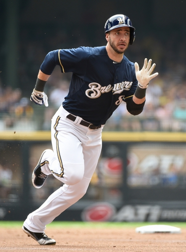 Aug 24, 2014; Milwaukee, WI, USA;   Milwaukee Brewers right fielder Ryan Braun (8) goes first to third on a base hit by third baseman Aramis Ramirez (not pictured) in the first inning during the game against the Pittsburgh Pirates at Miller Park. Mandatory Credit: Benny Sieu-USA TODAY Sports