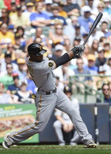 Aug 24, 2014; Milwaukee, WI, USA;  Pittsburgh Pirates left fielder Starling Marte (6) hits a two--run homer in the second inning against the Milwaukee Brewers at Miller Park. Mandatory Credit: Benny Sieu-USA TODAY Sports
