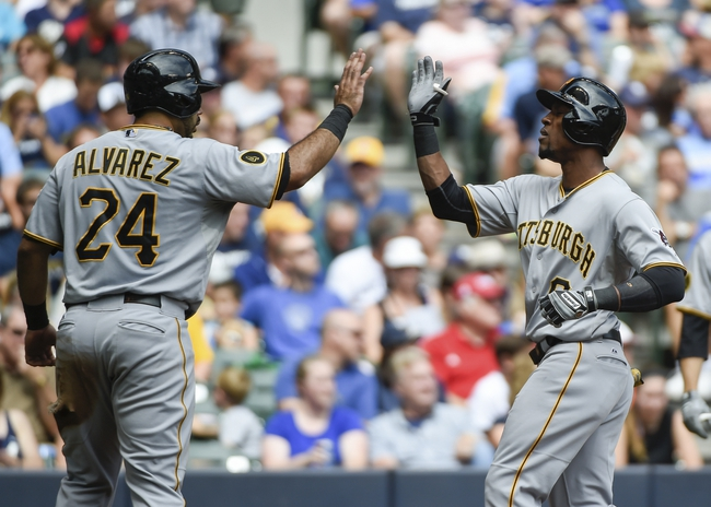 Aug 24, 2014; Milwaukee, WI, USA;  Pittsburgh Pirates left fielder Starling Marte (6) is greeted by first baseman Pedro Alvarez (24) after hitting a two-run homer in the second inning against the Milwaukee Brewers at Miller Park. Mandatory Credit: Benny Sieu-USA TODAY Sports