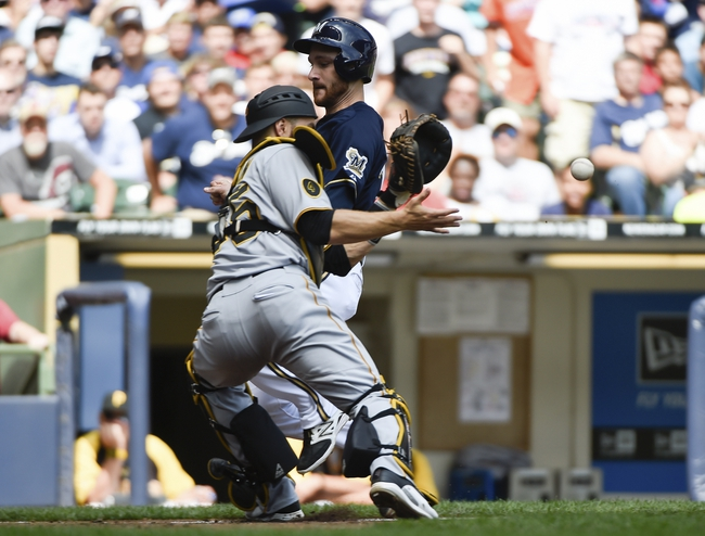 Aug 24, 2014; Milwaukee, WI, USA;   Milwaukee Brewers catcher Jonathan Lucroy (20) scores as Pittsburgh Pirates catcher Russell Martin (55) fields the throw in the second inning at Miller Park. Mandatory Credit: Benny Sieu-USA TODAY Sports