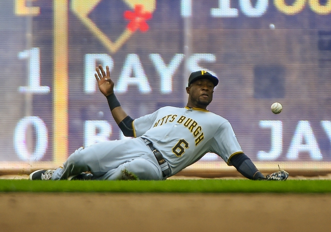 Aug 24, 2014; Milwaukee, WI, USA;   Pittsburgh Pirates left fielder Starling Marte (6) cannot catch a ball hit by Milwaukee Brewers third baseman Aramis Ramirez (not pictured) in the seventh inning at Miller Park. Mandatory Credit: Benny Sieu-USA TODAY Sports