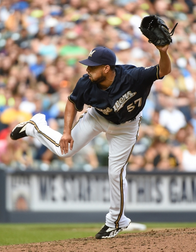 Aug 24, 2014; Milwaukee, WI, USA;  Milwaukee Brewers pitcher Francisco Rodriguez (57) pitches in the ninth inning against the Pittsburgh Pirates at Miller Park. Mandatory Credit: Benny Sieu-USA TODAY Sports