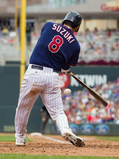 Aug 21, 2014; Minneapolis, MN, USA; Minnesota Twins catcher Kurt Suzuki (8) at bat in the against the Cleveland Indians at Target Field. Mandatory Credit: Brad Rempel-USA TODAY Sports