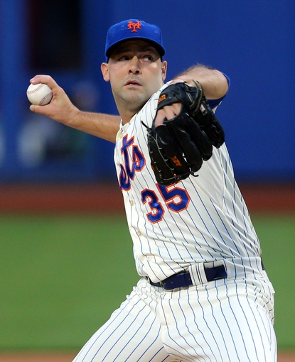 Aug 26, 2014; New York, NY, USA; New York Mets starting pitcher Dillon Gee (35) pitches against the Atlanta Braves during the first inning of a game at Citi Field. Mandatory Credit: Brad Penner-USA TODAY Sports