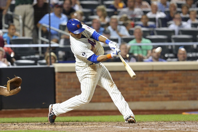 Aug 26, 2014; New York, NY, USA; New York Mets center fielder Juan Lagares (12) hits a two-run home run against the Atlanta Braves during the fourth inning of a game at Citi Field. Mandatory Credit: Brad Penner-USA TODAY Sports