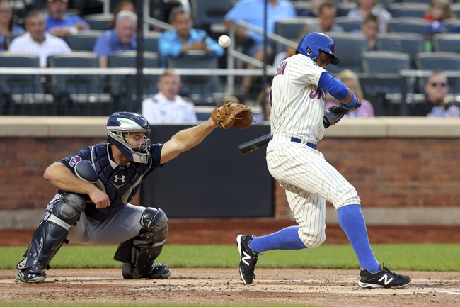 Aug 26, 2014; New York, NY, USA; New York Mets right fielder Curtis Granderson (3) is hit by a pitch during the first inning of a game against the Atlanta Braves at Citi Field. Mandatory Credit: Brad Penner-USA TODAY Sports