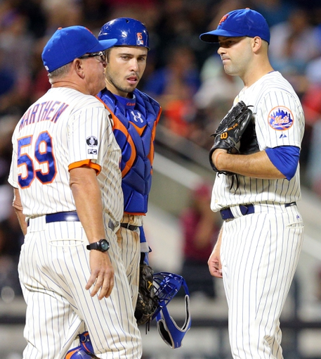 Aug 26, 2014; New York, NY, USA; New York Mets pitching coach Dan Warthen (59) talks with New York Mets catcher Travis d'Arnaud (15) and New York Mets starting pitcher Dillon Gee (35) during the seventh inning of a game against the Atlanta Braves at Citi Field. The Mets defeated the Braves 3-2. Mandatory Credit: Brad Penner-USA TODAY Sports