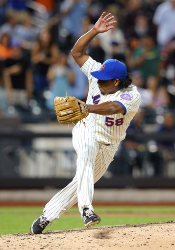 Aug 26, 2014; New York, NY, USA; New York Mets relief pitcher Jenrry Mejia (58) pitches against the Atlanta Braves during the ninth inning of a game at Citi Field. The Mets defeated the Braves 3-2. Mandatory Credit: Brad Penner-USA TODAY Sports
