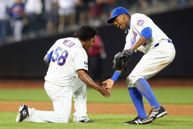 Aug 26, 2014; New York, NY, USA; New York Mets relief pitcher Jenrry Mejia (58) high fives New York Mets right fielder Curtis Granderson (3) after closing the game against the Atlanta Braves at Citi Field. The Mets defeated the Braves 3-2. Mandatory Credit: Brad Penner-USA TODAY Sports