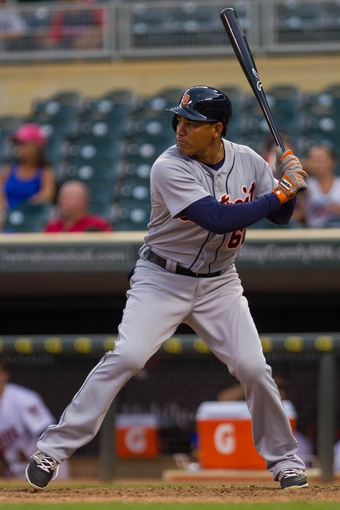 Aug 24, 2014; Minneapolis, MN, USA; Detroit Tigers outfielder Ezequiel Carrera (61) at bat against the Minnesota Twins at Target Field. Mandatory Credit: Brad Rempel-USA TODAY Sports