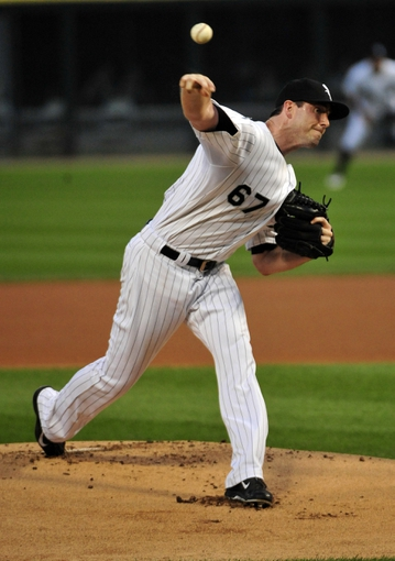 Aug 29, 2014; Chicago, IL, USA; Chicago White Sox starting pitcher Scott Carroll (67) throws against the Detroit Tigers during the first inning at U.S Cellular Field. Mandatory Credit: David Banks-USA TODAY Sports