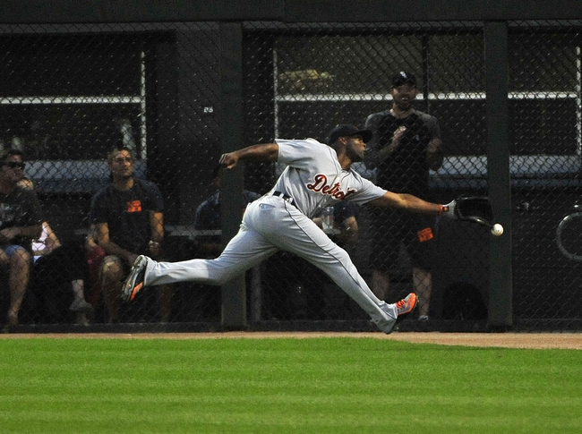 Aug 29, 2014; Chicago, IL, USA;  Detroit Tigers right fielder Torii Hunter (48) cannot make a catch on a double off the bat of Chicago White Sox right fielder Avisail Garcia (not pictured) during the first inning at U.S Cellular Field. Mandatory Credit: David Banks-USA TODAY Sports