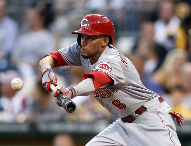 Aug 29, 2014; Pittsburgh, PA, USA; Cincinnati Reds center fielder Billy Hamilton (6) attempts to bunt for a base hit against the Pittsburgh Pirates during the third inning at PNC Park. Mandatory Credit: Charles LeClaire-USA TODAY Sports