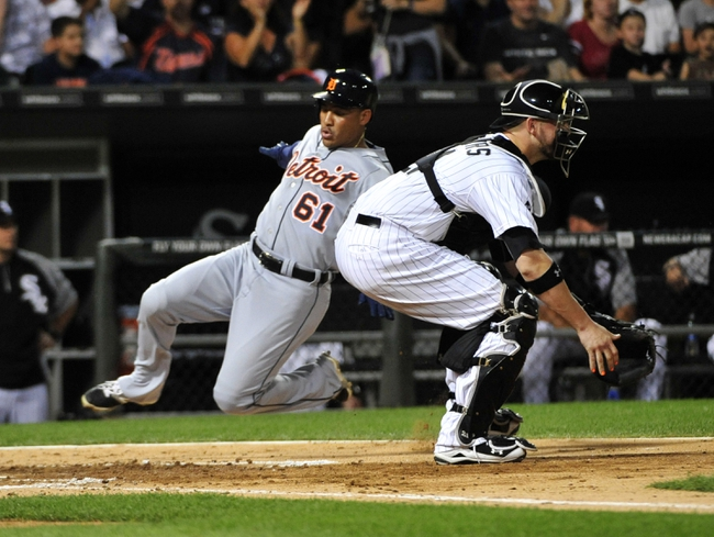 Aug 29, 2014; Chicago, IL, USA; Detroit Tigers center fielder Ezequiel Carrera (61) scores as Chicago White Sox catcher Tyler Flowers (21) takes the thrown during the third inning at U.S Cellular Field. Mandatory Credit: David Banks-USA TODAY Sports