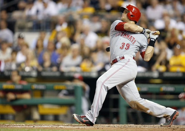 Aug 29, 2014; Pittsburgh, PA, USA; Cincinnati Reds catcher Devin Mesoraco (39) hits an RBI single against the Pittsburgh Pirates during the eighth inning at PNC Park. Mandatory Credit: Charles LeClaire-USA TODAY Sports