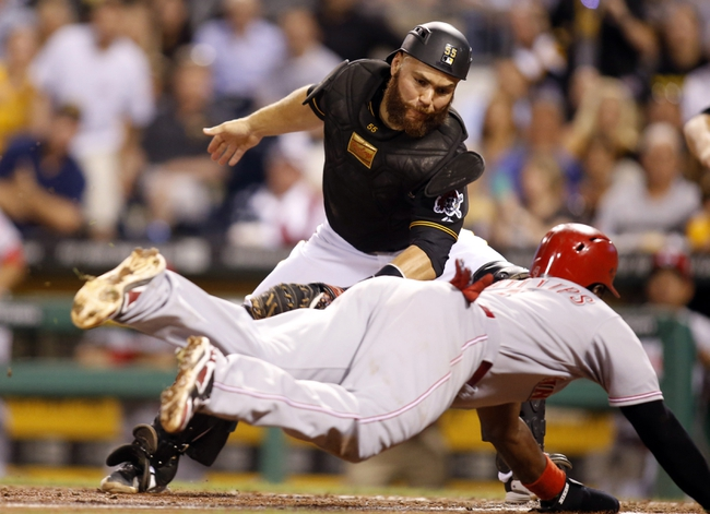 Aug 29, 2014; Pittsburgh, PA, USA; Pittsburgh Pirates catcher Russell Martin (55) tags out Cincinnati Reds second baseman Brandon Phillips (4) trying to score during the eighth inning at PNC Park. Mandatory Credit: Charles LeClaire-USA TODAY Sports