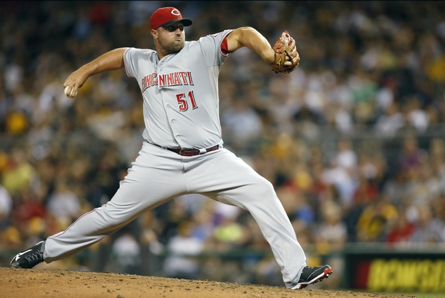Aug 29, 2014; Pittsburgh, PA, USA; Cincinnati Reds relief pitcher Jonathan Broxton (51) pitches against the Pittsburgh Pirates during the eighth inning at PNC Park. The Pirates won 2-1. Mandatory Credit: Charles LeClaire-USA TODAY Sports