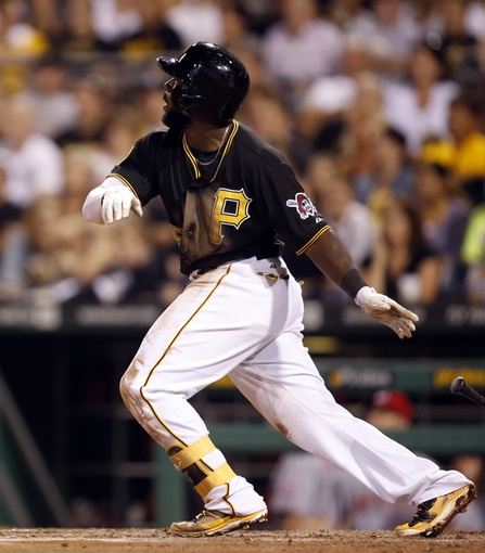 Aug 29, 2014; Pittsburgh, PA, USA; Pittsburgh Pirates third baseman Josh Harrison (5) hits an RBI triple against the Cincinnati Reds during the eighth inning at PNC Park. The Pirates won 2-1. Mandatory Credit: Charles LeClaire-USA TODAY Sports