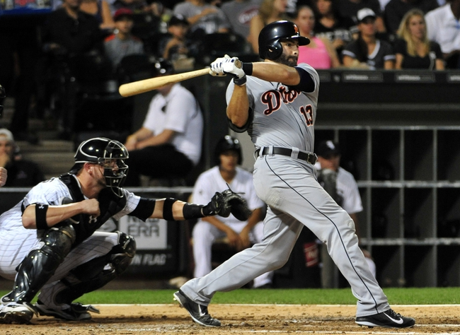 Aug 29, 2014; Chicago, IL, USA; Detroit Tigers catcher Alex Avila (13) hits an RBI double against the Chicago White Sox during the fourth inning at U.S Cellular Field. Mandatory Credit: David Banks-USA TODAY Sports