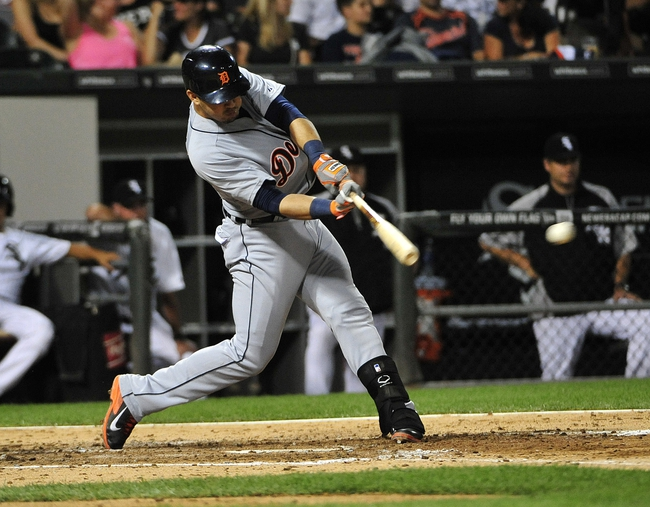 Aug 29, 2014; Chicago, IL, USA;  Detroit Tigers shortstop Eugenio Suarez (30) hits a single against the Chicago White Sox during the fourth inning at U.S Cellular Field. Mandatory Credit: David Banks-USA TODAY Sports