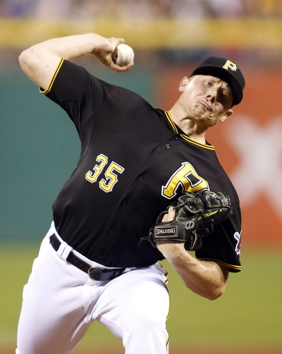 Aug 29, 2014; Pittsburgh, PA, USA; Pittsburgh Pirates relief pitcher Mark Melancon (35) pitches against the Cincinnati Reds during the ninth inning at PNC Park. The Pirates won 2-1. Mandatory Credit: Charles LeClaire-USA TODAY Sports