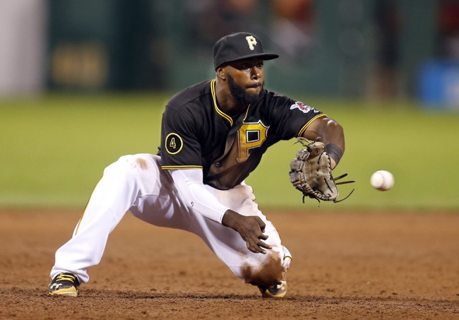 Aug 29, 2014; Pittsburgh, PA, USA; Pittsburgh Pirates third baseman Josh Harrison (5) fields a line drive against the Cincinnati Reds during the ninth inning at PNC Park. The Pirates won 2-1. Mandatory Credit: Charles LeClaire-USA TODAY Sports