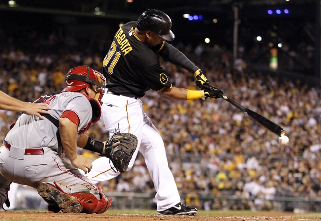 Aug 29, 2014; Pittsburgh, PA, USA; Pittsburgh Pirates right fielder Jose Tabata (31) singles against the Cincinnati Reds during the sixth inning at PNC Park. The Pirates won 2-1. Mandatory Credit: Charles LeClaire-USA TODAY Sports