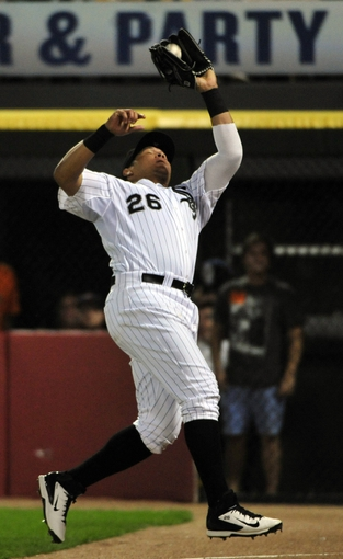 Aug 29, 2014; Chicago, IL, USA; Chicago White Sox right fielder Avisail Garcia (26) makes a catch on Detroit Tigers first baseman Miguel Cabrera not pictured) during the fifth inning at U.S Cellular Field. Mandatory Credit: David Banks-USA TODAY Sports
