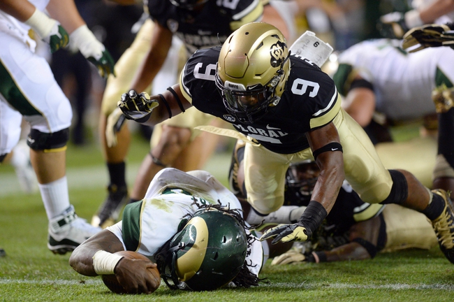 Aug 29, 2014; Denver, CO, USA; Colorado State Rams running back Dee Hart (10) rushes for touchdown as Colorado Buffaloes defensive back Tedric Thompson (9) defends in the second quarter at Sports Authority Field at Mile High. Mandatory Credit: Ron Chenoy-USA TODAY Sports