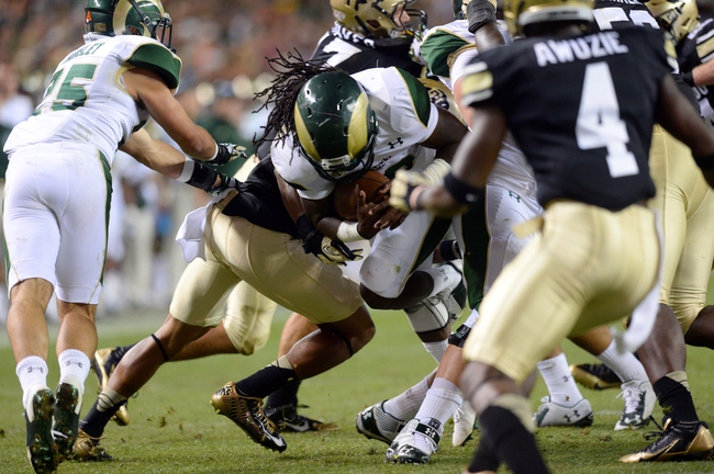 Aug 29, 2014; Denver, CO, USA; Colorado State Rams running back Dee Hart (10) rushes and scores a touchdown against the Colorado Buffaloes in the second quarter at Sports Authority Field at Mile High. Mandatory Credit: Ron Chenoy-USA TODAY Sports
