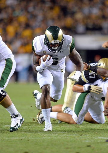 Aug 29, 2014; Denver, CO, USA; Colorado State Rams running back Jasen Oden Jr. (6) rushes against the Colorado Buffaloes in the second quarter at Sports Authority Field at Mile High. Mandatory Credit: Ron Chenoy-USA TODAY Sports