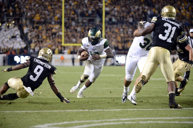 Aug 29, 2014; Denver, CO, USA; Colorado State Rams running back Dee Hart (10) scores a rushing touchdown against the Colorado Buffaloes in the fourth quarter at Sports Authority Field at Mile High. Mandatory Credit: Ron Chenoy-USA TODAY Sports