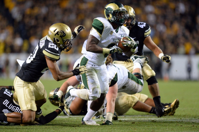 Aug 29, 2014; Denver, CO, USA; Colorado State Rams running back Treyous Jarrells (3) rushes against the Colorado Buffaloes in the fourth quarter at Sports Authority Field at Mile High. Mandatory Credit: Ron Chenoy-USA TODAY Sports