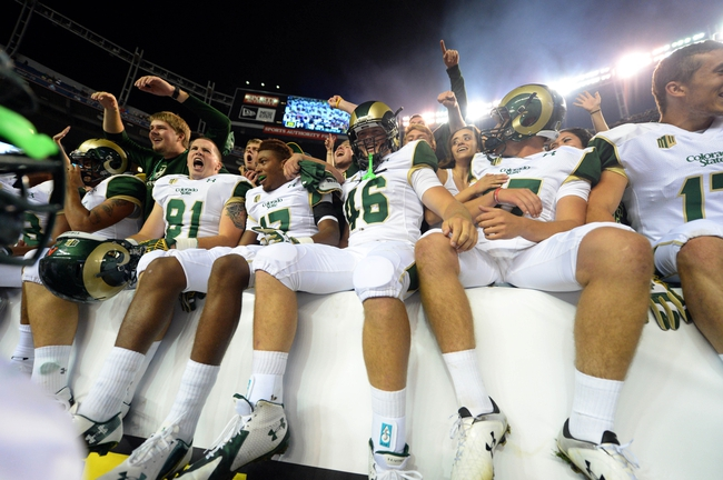 Aug 29, 2014; Denver, CO, USA; Members of the Colorado State Rams react with fans following the win over the Colorado Buffaloes at Sports Authority Field at Mile High. Mandatory Credit: Ron Chenoy-USA TODAY Sports