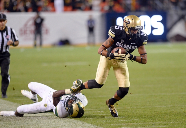 Aug 29, 2014; Denver, CO, USA; Colorado State Rams defensive back Bernard Blake (23) leg tackles Colorado Buffaloes wide receiver Shay Fields (5) in the third quarter at Sports Authority Field at Mile High. The Rams defeated the Buffaloes 31-17. Mandatory Credit: Ron Chenoy-USA TODAY Sports