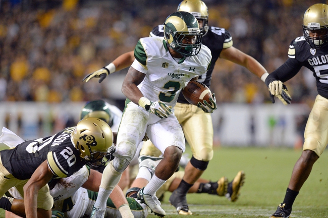 Aug 29, 2014; Denver, CO, USA; Colorado State Rams running back Treyous Jarrells (3) rushes against the Colorado Buffaloes in the fourth quarter at Sports Authority Field at Mile High. The Rams defeated the Buffaloes 31-17. Mandatory Credit: Ron Chenoy-USA TODAY Sports