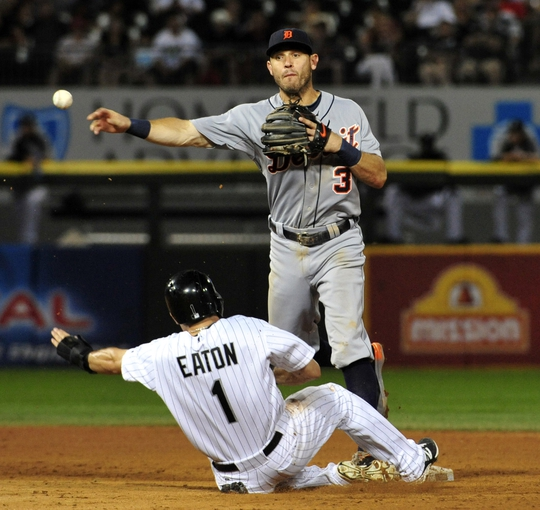 Aug 29, 2014; Chicago, IL, USA; Detroit Tigers second baseman Ian Kinsler (3) forces out Chicago White Sox center fielder Adam Eaton (1) during the fifth inning at U.S Cellular Field. Mandatory Credit: David Banks-USA TODAY Sports
