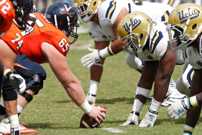 Aug 30, 2014; Charlottesville, VA, USA; Virginia Cavaliers offensive players line up against UCLA Bruins defensive players in the third quarter at Scott Stadium. The Bruins won 28-20. Mandatory Credit: Geoff Burke-USA TODAY Sports