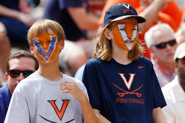Aug 30, 2014; Charlottesville, VA, USA; Virginia Cavaliers fans watch from the stands against the UCLA Bruins in the fourth quarter at Scott Stadium. The Bruins won 28-20. Mandatory Credit: Geoff Burke-USA TODAY Sports