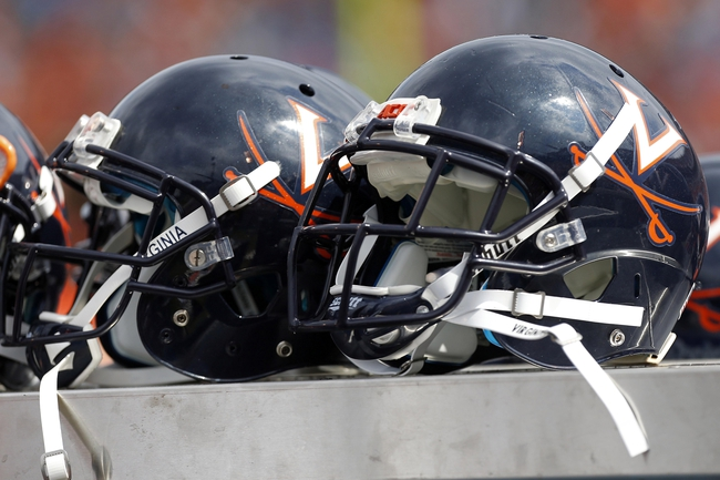 Aug 30, 2014; Charlottesville, VA, USA; Virginia Cavaliers players' helmets rest on the bench against the UCLA Bruins in the fourth quarter at Scott Stadium. The Bruins won 28-20. Mandatory Credit: Geoff Burke-USA TODAY Sports