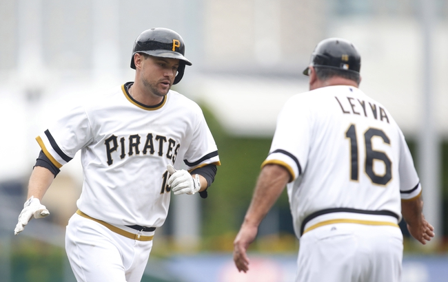 Aug 31, 2014; Pittsburgh, PA, USA; Pittsburgh Pirates shortstop Jordy Mercer (10) is greeted by third base coach Nick Leyva (16) after Mercer hit a solo home run against the Cincinnati Reds during the second inning at PNC Park. Mandatory Credit: Charles LeClaire-USA TODAY Sports