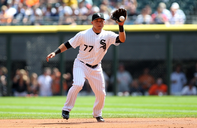 Aug 31, 2014; Chicago, IL, USA; Chicago White Sox second baseman Carlos Sanchez (77) fields a ground ball hit by Detroit Tigers designated hitter Victor Martinez (not pictured) during the first inning at U.S Cellular Field. Mandatory Credit: Jerry Lai-USA TODAY Sports