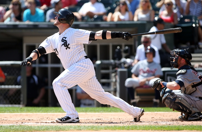 Aug 31, 2014; Chicago, IL, USA; Chicago White Sox catcher Tyler Flowers hits a single against the Detroit Tigers during the second inning at U.S Cellular Field. Mandatory Credit: Jerry Lai-USA TODAY Sports