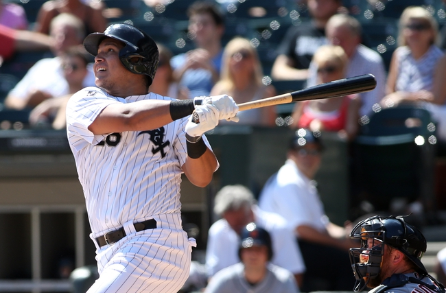Aug 31, 2014; Chicago, IL, USA; Chicago White Sox right fielder Avisail Garcia hits a RBI single against the Detroit Tigers during the second inning at U.S Cellular Field. Mandatory Credit: Jerry Lai-USA TODAY Sports