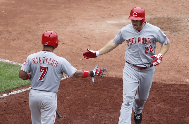 Aug 31, 2014; Pittsburgh, PA, USA; Cincinnati Reds third baseman Ramon Santiago (7) high-fives right fielder Chris Heisey (28) after Heisey hit a game winning solo home run against the Pittsburgh Pirates during the ninth inning at PNC Park. The Reds won 3-2. Mandatory Credit: Charles LeClaire-USA TODAY Sports